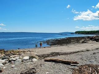 The private beach at the cottage at low tide is a great spot for kids and adults to enjoy the ocean