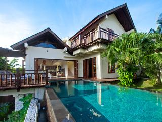 Exterior of Villa Cantik, swimming pool,deck with sun bed