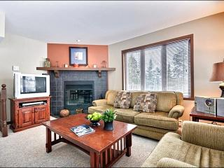 The Spacious Living Area Features a Cozy Wood Burning Fireplace
