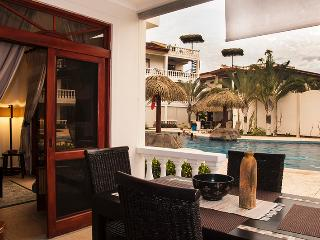 The patio dining area offers a fabulous view of the main pool and waterfall.