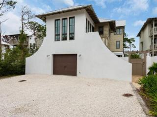 Rolling Dune Carriage is an adorable, comfortable Carriage house, sleeping 4. Provides 1 Parking Spot in Shared Driveway.