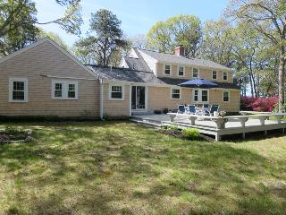 Exterior back with great yard and deck- Easy access to rail trail ! Bike to Public area on Long Pond!