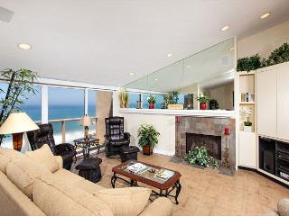 Light and bright oceanfront living room with fireplace
