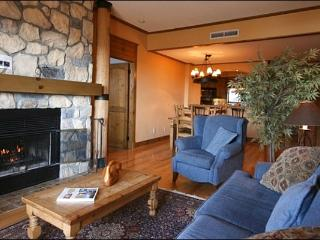 The Cozy Living Area Features a Flat Screen TV and a Beautiful Stone Fireplace