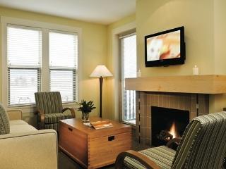 Neutral hues and large windows make this condo bright and inviting