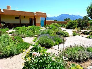 Lush courtyard landscaping, awe inspiring mountains, total peace and quiet create a perfect vacation getaway