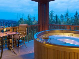 Soak your tired skiing or biking legs in your private hot tub.