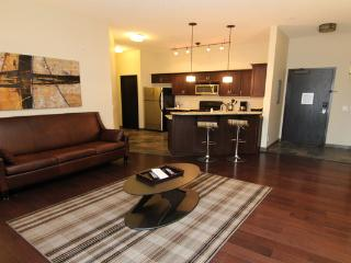 The condo features sleek, modern furnishings and a large living space