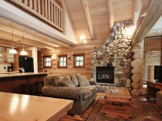 This fabulous home boasts a beautiful stone fireplace.