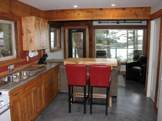 The 1 Bedroom Lodge features a fully-equipped kitchen and a living space