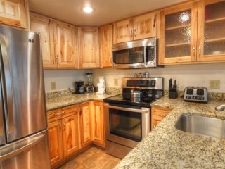 """SkyRun Property - """"CM216 and 212 Copper Mtn Inn"""" - Kitchen - There are 4 additional seats at the breakfast bar."""