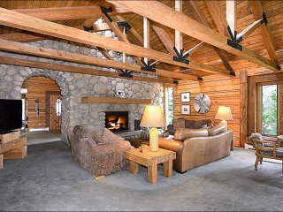 Living Room with Vaulted Ceilings and Large Stone Fireplace