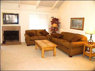 Comfortable living room with wood burning fireplace