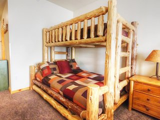 """SkyRun Property - """"TM407H Tucker Mtn Lodge"""" - Hotel Room - This hotel room has a set of bunk beds with a double on the bottom and twin on top."""