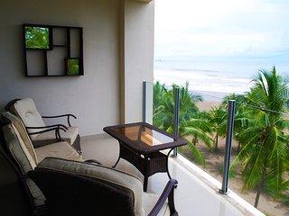Lounge balcony with beachfront views