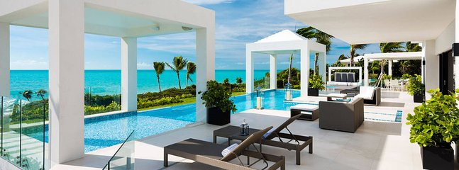 When in doubt, go on vacation. 10,000 sq. ft. beachfront estate, 2 pools, tennis court