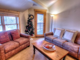 "SkyRun Property - ""2662 Tenderfoot Lodge"" - Living Room - Comfortable living room with nice views and a gas fireplace"