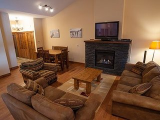 Gather around the fireplace after a day on the slopes in the large living area