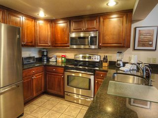 """SkyRun Property - """"CM336 and CM337 Copper Mtn Inn"""" - Kitchen  - There are 4 seats at the bar"""