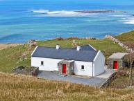 RUSSELL FAMILY COTTAGE, pet friendly, with a garden in Doolin, County Clare, Ref 8338