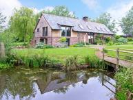 THE GRANARY, quality accommodation, picture windows, woodburner, private patios, rural location in Coed Morgan, Ref 15022