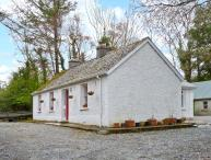 TREE GROVE COTTAGE, pet-friendly, single-storey cottage with open fires, patio, Kinlough Ref 21696