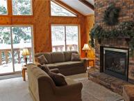 Located at Base of Powderhorn Mtn in the Western Upper Peninsula, A Large Trailside Home with Spacious Living Room with Large Windows