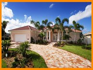 Amazing 4 Bedroom Cape Coral Vacation Rental with boat dock and private pool with hot tub.